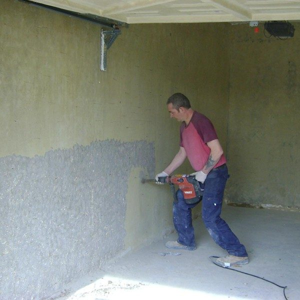 Bush hammering to prepare walls for tanking