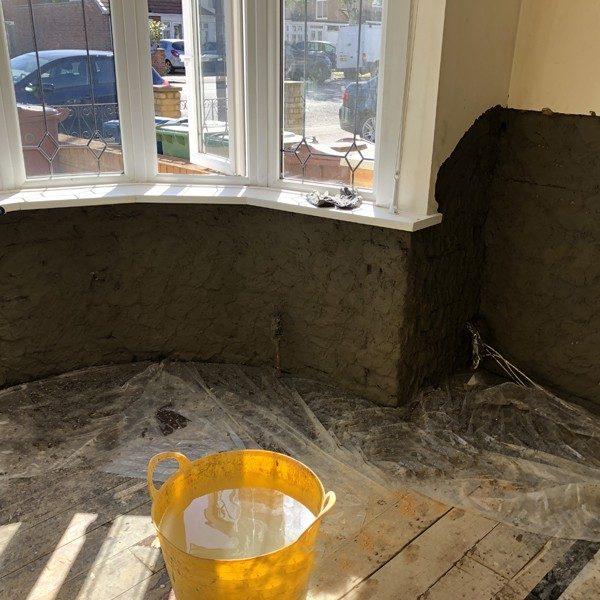 Waterproof render was applied over the walls to a height of 1.2m
