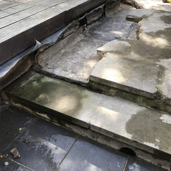 Damp and wood rot in the basement was caused by a  leak from patio above