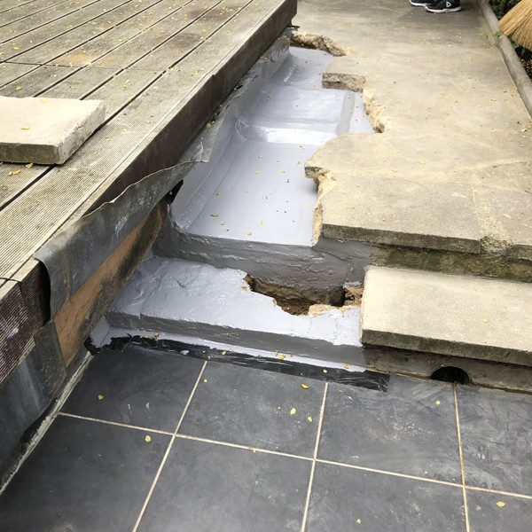 The crack under the slab was hollowed and filled with waterproof cement