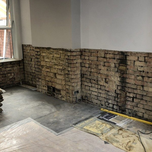 Project 2: The plaster was hacked off to reveal the rising damp