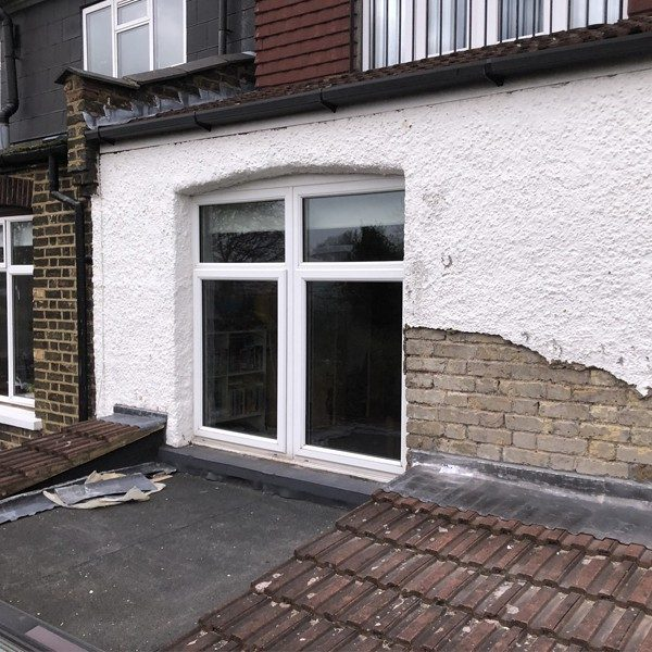 Existing external render broken away and lead flashing compromised